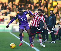 Lincoln City's Bruno Andrade vies for possession with  Port Vale's Emmanuel Oyeleke<br /> <br /> Photographer Andrew Vaughan/CameraSport<br /> <br /> The EFL Sky Bet League Two - Lincoln City v Port Vale - Tuesday 1st January 2019 - Sincil Bank - Lincoln<br /> <br /> World Copyright &copy; 2019 CameraSport. All rights reserved. 43 Linden Ave. Countesthorpe. Leicester. England. LE8 5PG - Tel: +44 (0) 116 277 4147 - admin@camerasport.com - www.camerasport.com