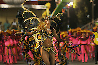 A samba dancer performs at the Sambadrome during the samba school parade, Rio de Janeiro, Brazil, February 28. 2014. (Austral Foto/Renzo Gostoli)