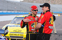 Nov. 13, 2009; Avondale, AZ, USA; NASCAR Sprint Cup Series driver Martin Truex Jr (left) talks with crew chief Kevin Manion during qualifying for the Checker O'Reilly Auto Parts 500 at Phoenix International Raceway. Mandatory Credit: Mark J. Rebilas-