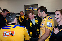 Prince Harry mingles with the Hurricanes team (including James Marshall, foreground) in the Hurricanes changing rooms after the Super Rugby match between the Hurricanes and Sharks at Westpac Stadium, Wellington, New Zealand on Saturday, 9 May 2015. Photo: Dave Lintott / lintottphoto.co.nz