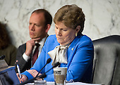 """United States Senator Jeanne Shaheen (Democrat of New Hampshire) writes notes as US Secretary Of Defense Ashton B. Carter and General Joseph F. Dunford, Jr., USMC, Chairman of The Joint Chiefs Of Staff testify before the US Senate Committee on Armed Services on """"Counter-ISIL (Islamic State of Iraq and the Levant) Operations and Middle East Strategy"""" on Capitol Hill in Washington, DC on Thursday, April 28, 2016.<br /> Credit: Ron Sachs / CNP"""