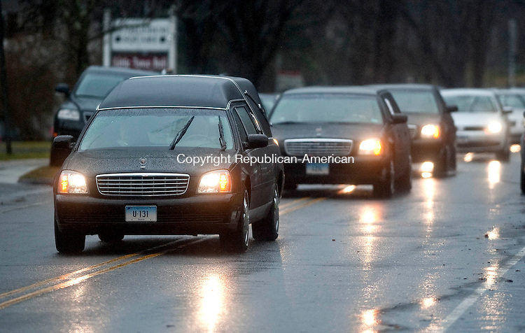 BETHLEHEM, CT 21 DECEMBER- 122112JS01- The funeral precession makes its way down East Street in Bethlehem for the funeral for Rachel D'Avino Friday at the Church of the Nativity in Bethlehem. D'Avino was  a behavioral therapist at Sandy Hook Elementary School in Newtown.  .Jim Shannon Republican American