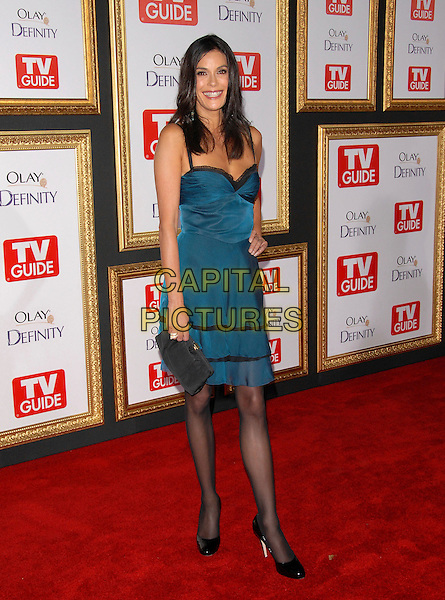 TERI HATCHER.attends The TV Guide Post Emmy Party 2007 held at Les Deux in Hollywood, California, USA, September 16 2007.                                                                                        full length blue teal dress black lace trim clutch bag tights patent shoes hand on hip.CAP/DVS.©Debbie VanStory/Capital Pictures
