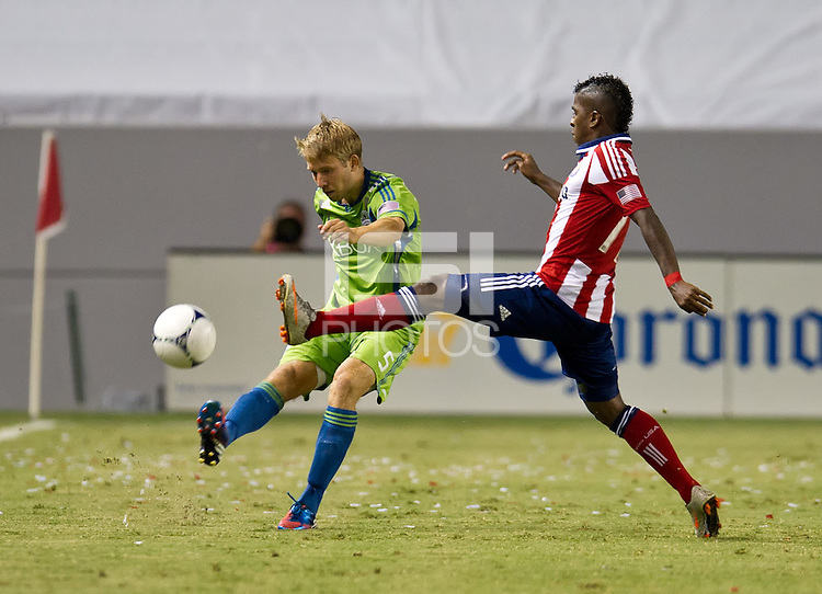 CARSON, CA - August 25, 2012: Seattle defender Adam Johansson (5) and Chivas USA midfielder Miller Bolanos (17) during the Chivas USA vs Seattle Sounders match at the Home Depot Center in Carson, California. Final score, Chivas USA 2, Seattle Sounders 6.