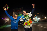 "2 people run at 6:00 AM on the 20th Korrika. Baltierra (Basque Country). April 1, 2017. The ""Korrika"" is a relay course, with a wooden baton that passes from hand to hand without interruption, organised every two years in a bid to promote the basque language. The Korrika runs over 11 days and 10 nights, crossing many Basque villages and cities. This year was the 20th edition and run more than 2500 Kilometres. Some people consider it an honour to carry the baton with the symbol of the Basques, ""buying"" kilometres to support Basque language teaching. (Gari Garaialde / Bostok Photo)"
