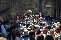 Michael McCollum.6/22/11.A crowd flows down one of the many stone lined streets in Pompeii Italy.