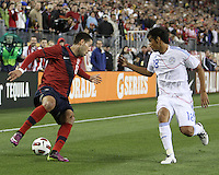 Clint Dempsey(8) of the USA MNT  moves the ball back from Marcelo Alejandro Estigambia(18) of Paraguay during an international friendly match at LP Field, in Nashville, TN. on March 29, 2011.Paraguay won 1-0.