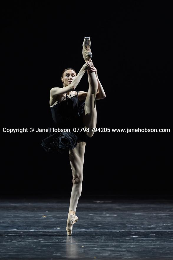 "London, UK. 02.12.19. Svetlana Zakharova, the Bolshoi's Prima and the first and only Russian Etpile at Teatro alla Scala, returns to the London Coliseum, with MODANSE, a new double bill produced by Muzarts. Zakharova is joined on stage by a cast of dancers from the Bolshoi Ballet, including Mikhail Lobukhin, Vaycheslav Lopatin, Denis Savin, Jacopo Tissi and Ana Turazashvili. The piece shown is: 'Come un Respiro"" (Like a Breath), choreographed by Mauro Bigonzetti, in its UK premiere. The dancers are: Svetlana Zakharova, Denis Savin, Jacopo Tissi, Mikhail Lobukhin, Vyacheslav Lopatin, Ana Turazashvili, Anastasia Stashkevich, Victoria Litvinova, Marfa Fyodorova, Tatiana Osipova, Anita Pudikova, Anna Zakaraya, Karim Abdullin, Alexei Gaynutdinov, Anton Gaynutdinov. Picture shows: Svetlana Zakharova. Photograph © Jane Hobson."