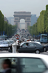 Traffic moving along the Champs ...lysÈes in Paris. With the Arc de Triomphe in the background.
