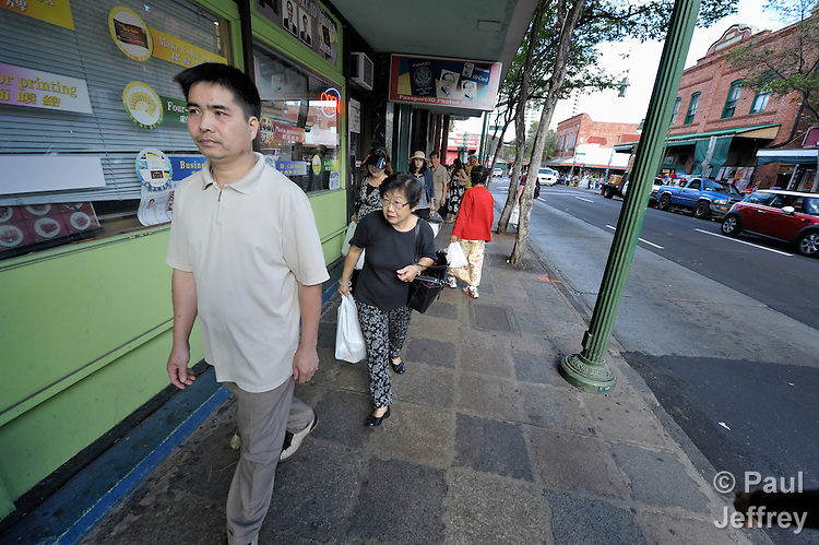 Hai Van Hoang, a Vietnamese survivor of human trafficking, walks through the Chinatown neighborhood of Honolulu, Hawaii. He has received assistance from the Susannah Wesley Community Center, which has played a key role in identifying and supporting victims of trafficking in Hawaii.