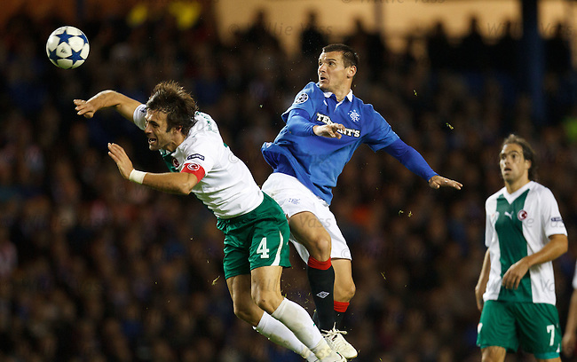 Lee McCulloch heads the ball back into play as he powers a header over defender Omer Erdogan