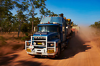 Truck drivers Nick and Joanna Atkins' road train, longer than an Olympic swimming pool, picks up speed over a smoother section of the Gibb River-Kalumburu Road.