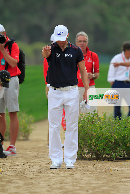 Martin Kaymer (GER) takes a drop after a wayward drive on the 13th hole during Sunday's Final Round of the Abu Dhabi HSBC Golf Championship 2015 held at the Abu Dhabi Golf Course, United Arab Emirates. 18th January 2015.<br /> Picture: Eoin Clarke www.golffile.ie
