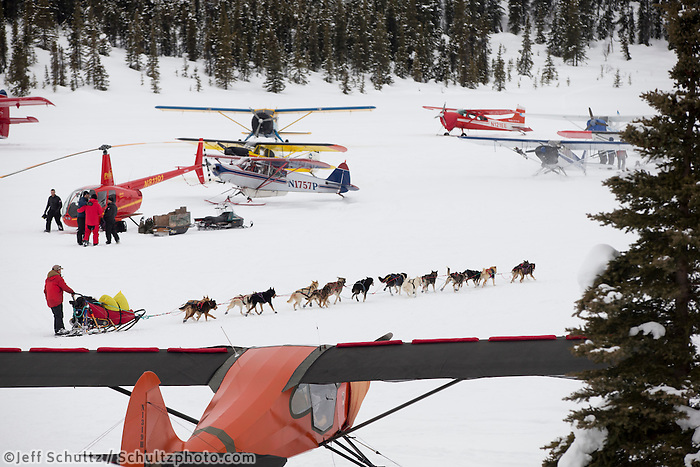 Jason Mackey runs on Puntilla Lake and weaves through parked airplanes as he leaves the Rainy Pass checkpoint on March 4, 2013.   Iditarod 2013