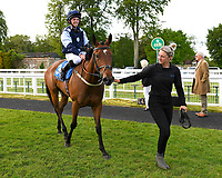 Winner of The Shadwell Stud Racing Excellence Apprentice Handicap Moorovertheridge left ridden by Harry Burns and trained by Grace Harris is led into the winners enclosure during Afternoon Racing at Salisbury Racecourse on 17th May 2018