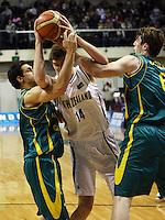 Tall Blacks centre Rob loe is checked by Oscar Foreman and AJ Ogilvy during the International basketball match between the NZ Tall Blacks and Australian Boomers at TSB Bank Arena, Wellington, New Zealand on 25 August 2009. Photo: Dave Lintott / lintottphoto.co.nz