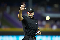 Home plate umpire Dane Poncsak signals to the press box during the Carolina League game between the Down East Wood Ducks and the Winston-Salem Dash at BB&T Ballpark on May 10, 2019 in Winston-Salem, North Carolina. The Wood Ducks defeated the Dash 9-2. (Brian Westerholt/Four Seam Images)