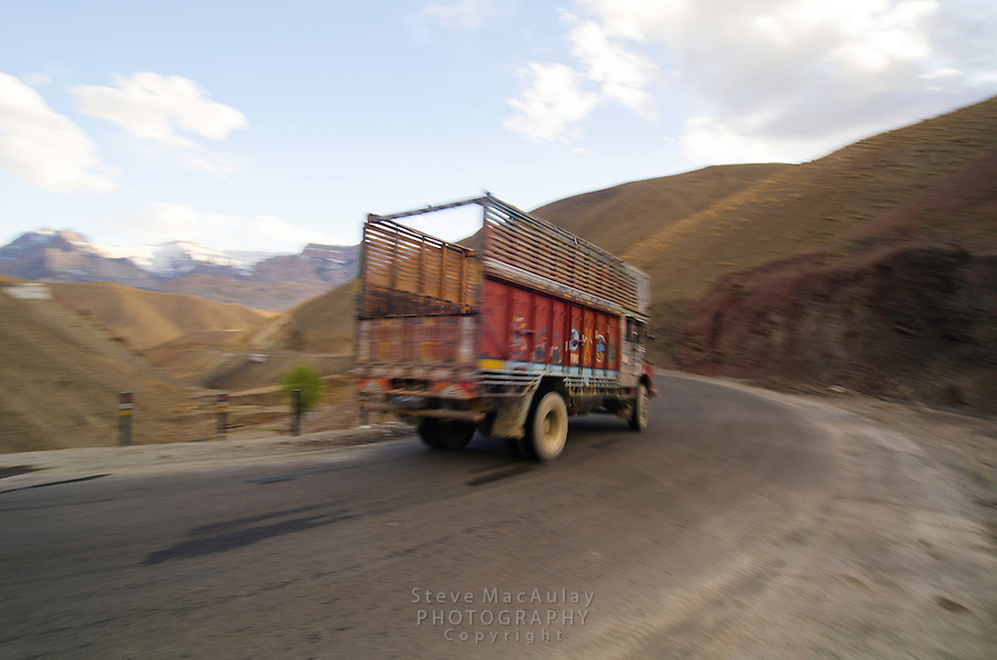 Speeding transport truck on the infamous Srinagar to Leh road. Kashmir Ladakh, India.