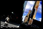 Woman crossing the street near Times Square.  New York City.  Street PhotographyNew York City, New York.  Street Photography from Manhattan and Brooklyn.  Subway, Union Square, Metro Stations, New York City Skyline, Michael Rubenstein, Matt Nager, Jacob Pritchard.