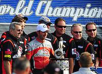 Nov. 13, 2011; Pomona, CA, USA; NHRA pro stock motorcycle rider Eddie Krawiec celebrates with his crew after clinching the world championship at the Auto Club Finals at Auto Club Raceway at Pomona. Mandatory Credit: Mark J. Rebilas-.