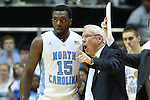 16 February 2013: UNC head coach Roy Williams (right) talks to P.J. Hairston (15). The University of North Carolina Tar Heels played the University of Virginia Cavaliers at the Dean E. Smith Center in Chapel Hill, North Carolina in a 2012-2013 NCAA Division I and Atlantic Coast Conference men's college basketball game. UNC won the game 93-81.