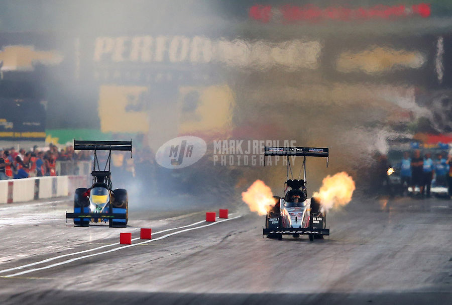 Aug. 30, 2013; Clermont, IN, USA: NHRA top fuel dragster driver Chris Karamesines (right) alongside Sidnei Frigo during qualifying for the US Nationals at Lucas Oil Raceway. Mandatory Credit: Mark J. Rebilas-
