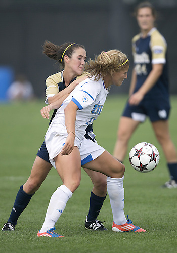 September 01, 2013:  UCLA forward Rosie White (13) and Notre Dame midfielder Elizabeth Tucker (8) battle for the ball during NCAA Soccer match between the Notre Dame Fighting Irish and the UCLA Bruins at Alumni Stadium in South Bend, Indiana.  UCLA defeated Notre Dame 1-0.