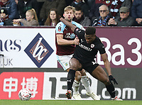 Barnsley's Dimitri Cavare holds off the challenge from Burnley's Charlie Taylor<br /> <br /> Photographer Rich Linley/CameraSport<br /> <br /> Emirates FA Cup Third Round - Burnley v Barnsley - Saturday 5th January 2019 - Turf Moor - Burnley<br />  <br /> World Copyright &copy; 2019 CameraSport. All rights reserved. 43 Linden Ave. Countesthorpe. Leicester. England. LE8 5PG - Tel: +44 (0) 116 277 4147 - admin@camerasport.com - www.camerasport.com
