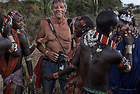 Even without a good road and with NO bridges over the Omo river, intrepid tourists have already found their way into the Omo valley.  Tribal women check out a tourist who traveled to see and photograph a cultural ritual..