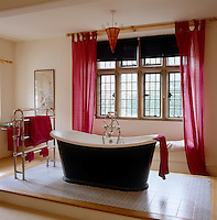 A free-standing roll top bath sits on a dais in one of the guestrooms - a suggestion by a previous occupant of the house Debo, the Dowager Duchess of Devonshire - to avoid anything so vulgar as an en-suite bathroom