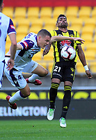 Jason Davidson and Roy Krishna compete for the ball during the A-League football match between Wellington Phoenix and Perth Glory at Westpac Stadium in Wellington, New Zealand on Saturday, 2 December 2018. Photo: Dave Lintott / lintottphoto.co.nz