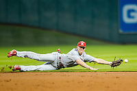 Nebraska Cornhuskers second baseman Jake Schelppenbach (6) dives for a ground ball during the Houston College Classic against the LSU Tigers on March 8, 2015 at Minute Maid Park in Houston, Texas. LSU defeated Nebraska 4-2. (Andrew Woolley/Four Seam Images)