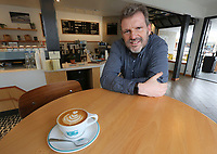 March 20, 2019. San Diego, CA. USA|  Bird Rock Coffee Roasters owner Jeff Taylor with a cappachino at his shop in Pacific Beach. | Photos by Jamie Scott Lytle. Copyright.