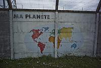 """The nuclear plant company offered the outer walls of the plant to schoolchildren of riverside towns in the 1990s.  Children have produced frescoes representing the different regions of the world.<br /> <br /> """"Fenêtre avec vue"""" est publié dans le journal suisse La couleur des jours, n°18, printemps 2016.<br /> http://www.lacouleurdesjours.ch/sommaires.php?ID=36<br /> <br /> <br /> Lire également, dans sa version """"réglementée"""":<br /> <br /> http://www.ladocumentationfrancaise.fr/pages-europe/pe000036-sortir-du-nucleaire-au-caeur-du-mix-energetique-suisse-par-alexandre-mouthon/article<br /> <br /> Lire dans sa version originale """"non réglementée"""":<br /> <br /> http://alencontre.org/suisse/sortir-du-nucleaire-le-coeur-du-mix-energetique-suisse-place-dans-sa-perspective-europeenne.html"""