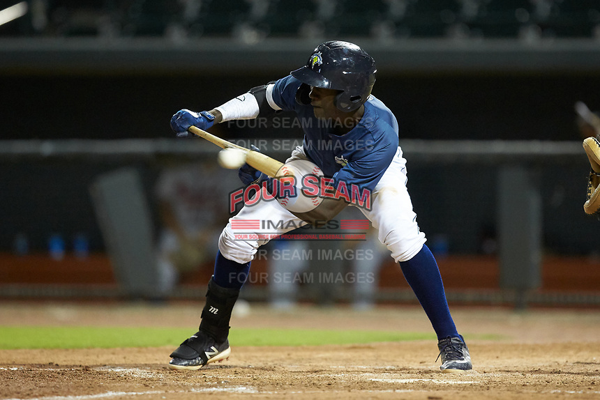Ronny Mauricio (2) of the Columbia Fireflies attempts to lay down a bunt against the Rome Braves at Segra Park on May 13, 2019 in Columbia, South Carolina. The Fireflies defeated the Braves 6-1 in game two of a doubleheader. (Brian Westerholt/Four Seam Images)
