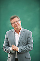 Rowland Rivron, Comic and TV Presenter and writer at The Edinburgh International Book Festival 2011. Having risen through the comedy ranks in the 80s, Rivron gained notoriety as the unpleasant Dr Martin Scrote on Jonathan Ross' The Last Resort and as one half of comedy band Raw Sex in French and Saunders. His memoir tells the story of the excess and silliness behind the scenes. Not many can say they have played football with Diana Ross in her Ritz suite, cycled down the staircase of the Groucho Club or set themselves on fire for money. Rivron has done all three. Credit Geraint Lewis