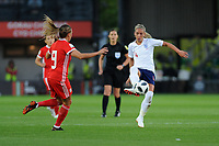NEWPORT, WALES - AUGUST 31:Kayleigh Green of Wales Women battles with Jordan Nobbs of England Women during the FIFA Women's World Cup Qualifier match between Wales and England at Rodney Parade on August 31, 2018 in Newport, Wales.