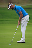 Matthew Baldwin (ENG) putts on the 5th green during Saturay's Round 3 of the 2014 BMW Masters held at Lake Malaren, Shanghai, China. 1st November 2014.<br /> Picture: Eoin Clarke www.golffile.ie