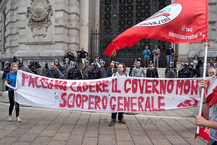 "Milano, ""Occupyamo Piazza Affari"", manifestazione di protesta di partiti e organizzazioni di estrema sinistra contro la crisi economica e i provvedimenti messi in atto dal governo. Davanti alla Banca d'Italia --- Milan, ""Occupy Piazza Affari"", demonstration of  extreme left parties and organizations to protest against the  economic crisis and the Government. At the Bank of Italy"