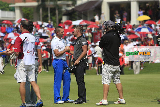 Ryan Moore (USA) on the 18th green after winning the CIMB Classic in the Kuala Lumpur Golf &amp; Country Club on Sunday 2nd November 2014. Shakes hands with Sergio Garcia (ESP).<br /> Picture:  Thos Caffrey / www.golffile.ie