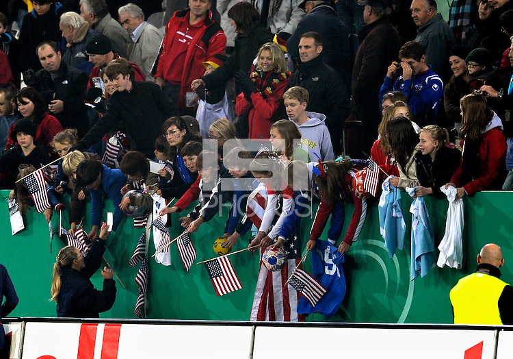 USA fans after the game. US Women's National Team defeated Germany 1-0 at Impuls Arena in Augsburg, Germany on October 27, 2009.