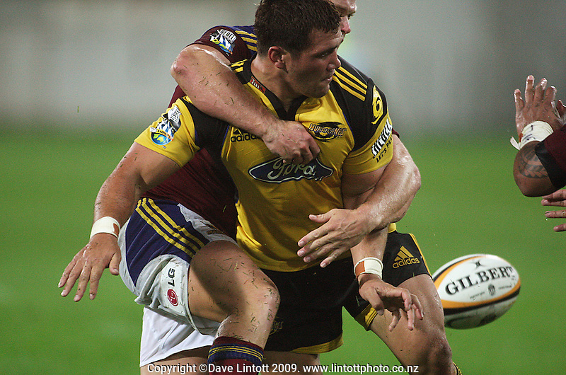 Karl Lowe is tackled by Highlanders captain Jason Shoemark during the Super 14 rugby union match between the Hurricanes and Highlanders at Westpac Stadium, Wellington, New Zealand on Friday 20 February 2009. Photo: Dave Lintott / lintottphoto.co.nz