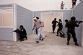 Mexico City, Mexico<br /> June 17, 2008<br /> <br /> A SWAP team of Federal Police practice hostage rescue maneuvers at the new federal police center.