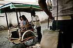 """Riding by tricicletta is the most popular way of getting around town. At the entrance of Tecun Uman, most tricicleras will ask, """"Va a Mexico?"""" or """"Going to Mexico?"""" to take you to the river. Over 12,000 migrants pass through Tecun Uman each year."""