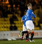 Marius Zaliukas runs away laughing and looking at his shoulder after scoring for Rangers