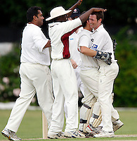 M Tucker (R) of Hornsey is congratulated after dismissing Bessborough batsman A Mehta during the Middlesex County Cricket League Division Three game between Hornsey and Bessborough at Tivoli Road, Crouch End on Sat June 13, 2009