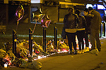 © Joel Goodman - 07973 332324 . No syndication permitted . 28 November 2013 . Bolton Road, Irlams o'th' Height , Salford , UK . Young friends of 18-year-old moped crash victim , Tom Ackerley , who was killed in a crash last night (27th November 2013) , hold a candlelit vigil at the scene of the crash . Tom Ackerley was killed when riding his moped , in a crash involving a taxi and a Vauxhall Astra , last night (27th November 2013) . Photo credit : Joel Goodman