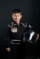Mar. 22, 2014; Chandler, AZ, USA; LOORRS junior 1 driver Niko Lopez poses for a portrait prior to round one at Wild Horse Motorsports Park. Mandatory Credit: Mark J. Rebilas-USA TODAY Sports