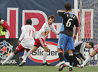 New York Red Bulls' Mike Magee, center, looks back at teammate Jozy Altidore (17) after Magee scored on a penalty kick as San Jose Earthquakes' goalkeeper, Joe Cannon looks down at the ball in the second half of an MLS soccer match at Giants Stadium in East Rutherford, N.J. on Sunday, April 27, 2008. The Red Bulls defeated the Earthquakes 2-0.
