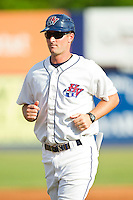 Hudson Valley Renegades manager Jared Sandberg (22) jogs to the third base coaches box during the New York-Penn League game against the Lowell Spinners at Dutchess Stadium on August 12, 2012 in Wappingers Falls, New York.  (Brian Westerholt/Four Seam Images)